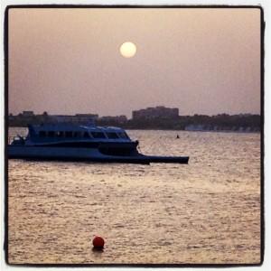 boat in the setting sun.
